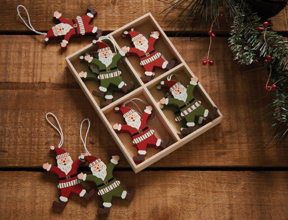 https://s3-ap-southeast-2.amazonaws.com/fusionfactory.commerceconnect.bbnt.production/pim_media/000/021/644/M_F-DECS-SET-TR-Wooden-Hanging-Santa-Decs-s12-Red-Green-17275001-alt.jpg?1572495732